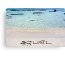 "The Word ""SOLEIL"" Written on Sand on a beautiful beach, with blue waves in background Canvas Print"
