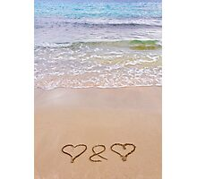 Two hearts drawn in the sand on a beautiful beach Photographic Print