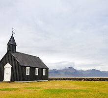 Historic black wooden church in Budir, Iceland by Stanciuc