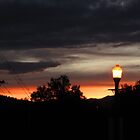 Street lamp in Colorado sunset by dfrahm