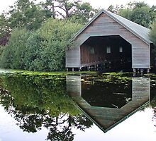Beautiful Reflection of the Boat House.  by Ben Frewin