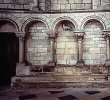 Arcade on wall with lamb of God central Cathedral Sens France 198405050111 by Fred Mitchell