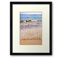 Word FREELANCER written in sand, on a beautiful beach Framed Print