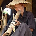 Village man smoking, Chiang Mai district by indiafrank
