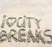 I Love City Breaks message written on sand by Stanciuc