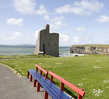 benches view of Ballybunion castle beach and cliffs by morrbyte