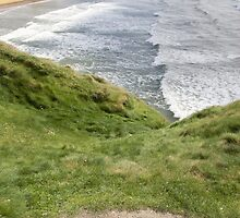 view of beach and cliffs in Ballybunion from bench by morrbyte