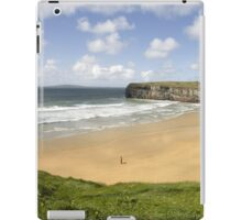 view of lone man at beach and cliffs in Ballybunion iPad Case/Skin