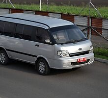 silver colored KIA travello by bayu harsa