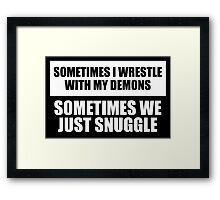Snuggle with my demons Framed Print