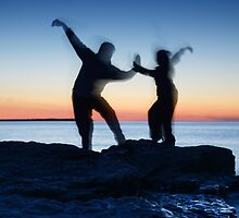 Blurred silhouettes of people practicing martial arts art photo print by ArtNudePhotos