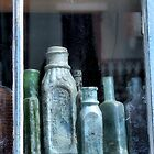 Old Bottles In An Old Window by SuddenJim