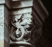 Grinning gargoyle on column capital Cathedral Notre Dame en Vaux France 198405060085 by Fred Mitchell