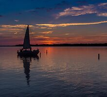 Sail boat at sunset by worthashot