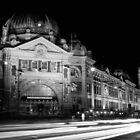 Streaking past Flinders Street Station - Melbourne Australia by Norman Repacholi