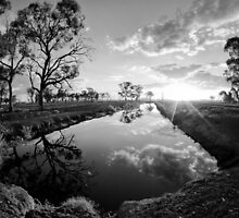 Reflections on irrigation channel - Tongala Victoria Australia by Norman Repacholi