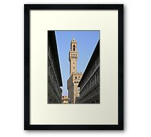 The tower of the Palazzo Vecchio seen through the Uffizi, Centro Storico, Florence, Italy Framed Print