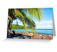 Sunbeds on exotic tropical palm beach, relax concept Greeting Card