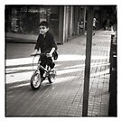 Kid on a Bike by Andy Freer