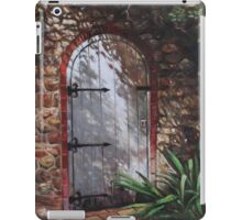 Decorative door in archway set in stone wall surrounded by plants iPad Case/Skin