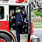Fireman Climbing into Fire Truck by Susan Savad