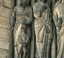 Abraham and Isaac at side of door Cathedral Laon France 198405070034 by Fred Mitchell
