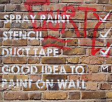 brick lane graffiti writing on the wall by andalaimaging