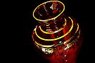 Red Vase On a Black Piano by AuntDot