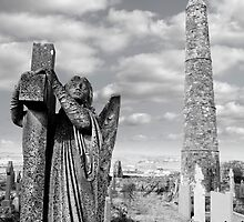 Archangel gravestone and Ancient round tower by morrbyte