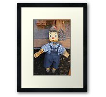 old wooden puppet Framed Print