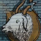 Goat mural Graffiti detail on the textured wall by yurix