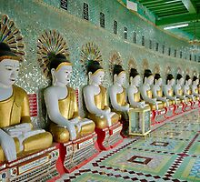 sitting Buddhas in Umin Thonze Pagoda by travel4pictures