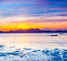 Sunset along the coast Sticker