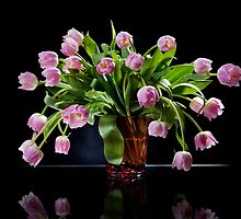 Pink tulips bouquet sag in glass vase by Arletta Cwalina
