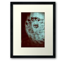 Multiple image of eye of young woman with makeup in dark analog film 35mm photo Framed Print