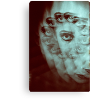 Multiple image of eye of young woman with makeup in dark analog film 35mm photo Canvas Print