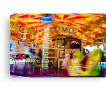 View of Carousel with horses on a carnival Merry Go Round Canvas Print