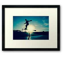 Skateboarder silhouette on a grind Framed Print
