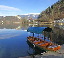 A Pletna wooden rowing boat on Lake Bled Slovenia by John Keates