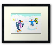 Penguins snowball fight Framed Print