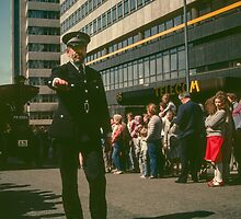 Arm of the law clearing road for tractor Traction Display Birmingham England 198405130011 by Fred Mitchell