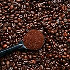 Coffee beans and scoop by DavidMay