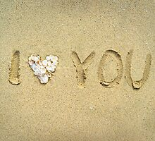 I love you written on wet sand on the beach by odstrcil