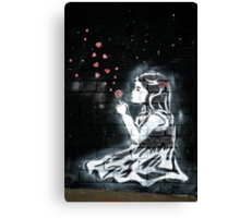 Girl blowing hearts by Banksy Canvas Print