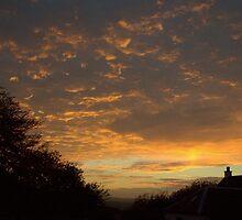 Sunset through Dark Clouds by printerbill