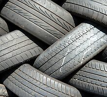 Old car tyres waiting for recycling. by DavidMay