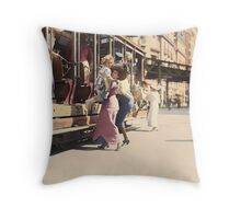 Mother helps her child off trolley in NYC — Colorized Throw Pillow