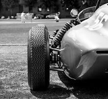 Classic racing #56 car sits in front of cricket match by bms-photo