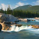 River and waterfall in early morning light by Philippe Widling