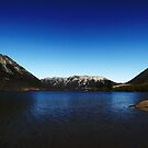 Lake Pearson Reflects the Blue Sky by PictureNZ